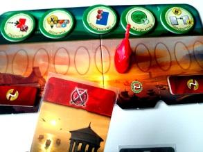 Czerwona karta budynku pozwala przesunąć pionek dominacji militarnej w kierunku miasta przeciwnika